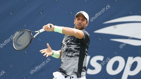 Stock Photo of Fernando Verdasco, of Spain, returns a shot to Tobias Kamke, of Germany, during the first round of the US Open tennis tournament, in New York