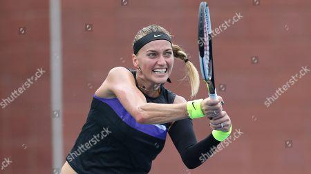 Stock Picture of Petra Kvitova, of the Czech Republic, receives serve from Denisa Allertova, of the Czech Republic, during the first round of the U.S. Open tennis tournament, in New York