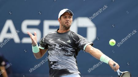 Stock Picture of Fernando Verdasco, of Spain, returns a shot to Tobias Kamke, of Germany, during the first round of the US Open tennis tournament, in New York