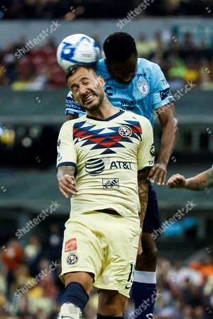 Victor Aguilera (L) of Club America in action against Oscar Murillo (R) of Pachuca during the Apertura Tournament soccer match between Club America and Pachuca, held at the Azteca Stadium in Mexico City, Mexico, 27 August 2019.