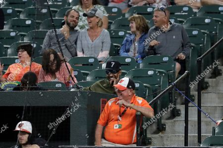 NBA basketball player Carmelo Anthony, center wearing sunglasses, watches the second inning of a baseball game between the Baltimore Orioles and the Tampa Bay Rays, in Baltimore
