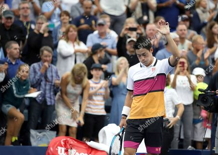 Kei Nishikori, of Japan, reacts after defeating Bradley Klahn, of the United States, during the second round of the US Open tennis championships, in New York