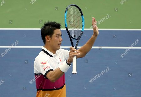 Kei Nishikori, of Japan, waves to the crowd after defeating Bradley Klahn, of the United States, during the second round of the US Open tennis championships, in New York