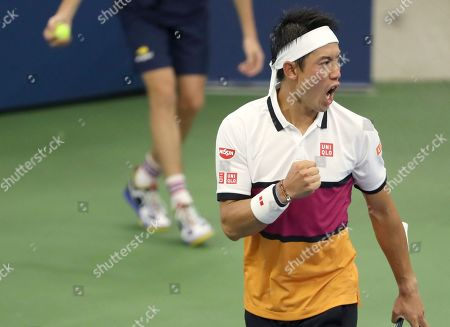 Kei Nishikori, of Japan, reacts after scoring a point against Bradley Klahn, of the United States, during the second round of the US Open tennis championships, in New York