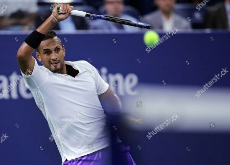 Stock Picture of Nick Kyrgios, of Australia, returns to Steve Johnson, of the United States, during the first round of the U.S. Open tennis tournament in New York, early