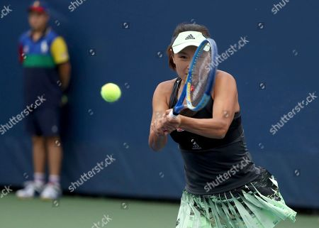 Peng Shuai, of China, returns a shot to Maria Sakkari, of Greece, during the second round of the US Open tennis championships, in New York