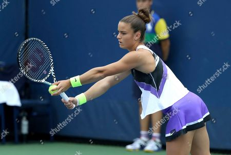 Maria Sakkari, of Greece, prepares to serve to Peng Shuai, of China, during the second round of the US Open tennis championships, in New York