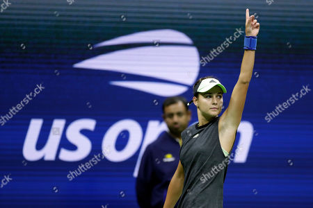 Anna Kalinskaya, of Russia, challenges a call against Sloane Stephens against during the first round of the U.S. Open tennis tournament, in New York