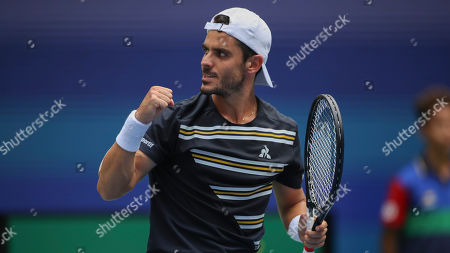 Thomas Fabbiano, of Italy, reacts after scoring a point against Dominic Thiem, of Austria, during the first round of the US Open tennis tournament, in New York