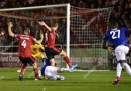 Michael O'Connor of Lincoln City and Harry Toffolo combine to foul Morgan Schneiderlin of Everton for a penalty scored by Gylfi Sigurdsson 1-1