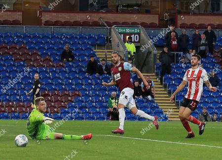 Jay Rodriguez of Burnley scores the opening goal