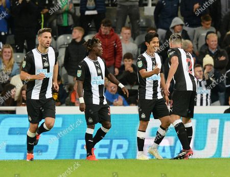 Yoshinori Muto of Newcastle United celebrates scoring their first goal (2nd from right)