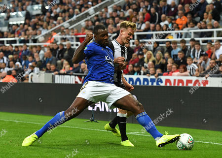 Wes Morgan of Leicester City vies for the ball with Matt Ritchie of Newcastle United