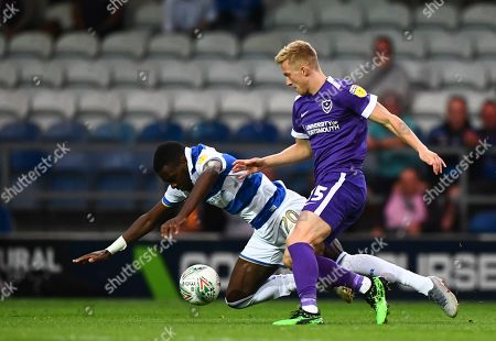Bright Osayi-Samuel of QPR battles with Ross McCrorie of Portsmouth