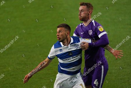 Jan Mlakar of QPR holds off Tom Naylor of Portsmouth