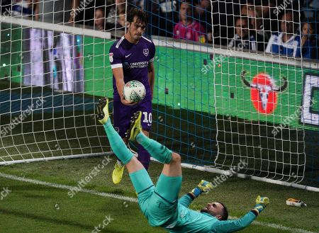 John Marquis of Portsmouth celebrates scoring the opening goal from a penalty by sarcastically giving the ball to QPR Goalkeeper Liam Kelly