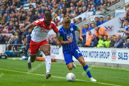 31st August  2019, DW Stadium, Wigan, England; Sky Bet Championship Football, Wigan Athletic vs Barnsley ; Michael Jacobs (17) of Wigan Athletic and Luke Thomas (16) of Barnsley contest the ball
