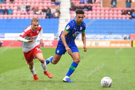 31st August  2019, DW Stadium, Wigan, England; Sky Bet Championship Football, Wigan Athletic vs Barnsley ; Antonee Robinson (3) of Wigan Athletic watched by Luke Thomas (16) of Barnsley 