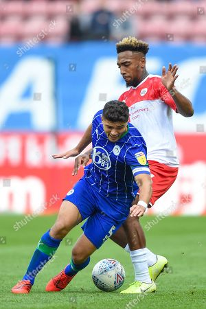 31st August  2019, DW Stadium, Wigan, England; Sky Bet Championship Football, Wigan Athletic vs Barnsley ; Sam Morsy (5) of Wigan Athletic is brought down by Mallik Wilks (36) of Barnsley 