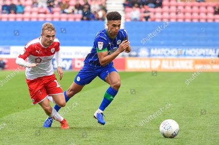 31st August  2019, DW Stadium, Wigan, England; Sky Bet Championship Football, Wigan Athletic vs Barnsley ; Antonee Robinson (3) of Wigan Athletic and Luke Thomas (16) of Barnsley chase down the ball