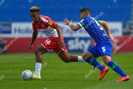 31st August  2019, DW Stadium, Wigan, England; Sky Bet Championship Football, Wigan Athletic vs Barnsley ; Sam Morsy (5) of Wigan Athletic tracks Mallik Wilks (36) of Barnsley 