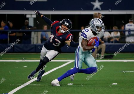 Stock Picture of Chris Johnson, Ced Wilson. Houston Texans safety Chris Johnson (43) attempts to stop Dallas Cowboys wide receiver Ced Wilson (16) from advancing the ball in the second half of a preseason NFL football game in Arlington, Texas