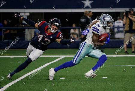 Chris Johnson, Ced Wilson. Houston Texans safety Chris Johnson (43) attempts to stop Dallas Cowboys wide receiver Ced Wilson (16) from advancing the ball in the second half of a preseason NFL football game in Arlington, Texas