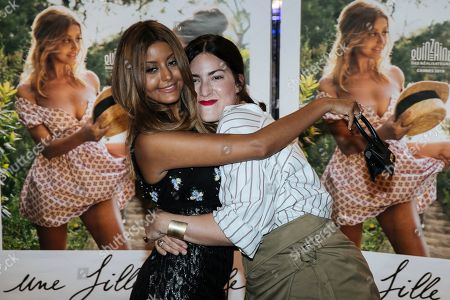 French lingerie designer and actress Zahia Dehar, left, and French director Rebecca Zlotowski hug as they pose during a photocall for the premiere of 'Une fille facile' in Paris