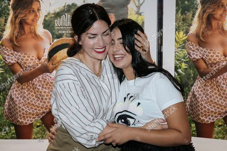 French director Rebecca Zlotowski, left, hugs French actress Mina Farid as they pose during a photocall for the premiere of 'Une fille facile' in Paris