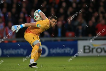 28th August 2019 , Sincil Bank, Lincoln, England; Carabao Cup Football, Second Round, Lincoln City vs Everton ; Grant Smith (21) of Lincoln City rolls the ball out Credit: Craig Milner/News Images English Football League images are subject to DataCo Licence