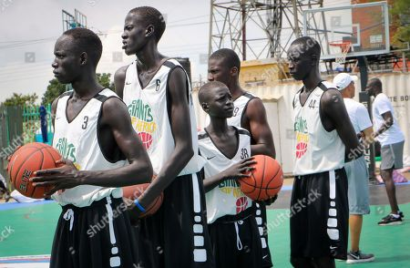 Stock Photo of Players stand on the court doing exercises during a three-day basketball training camp run by Giants of Africa in Juba, South Sudan. Masai Ujiri, president of the Toronto Raptors basketball team who won the NBA championship for the first time this year, is founder of the Giants of Africa non-profit organization which runs a three-day training camp in South Sudan to empower youth through basketball