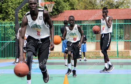 Players dribble during a three-day basketball training camp run by Giants of Africa in Juba, South Sudan. Masai Ujiri, president of the Toronto Raptors basketball team who won the NBA championship for the first time this year, is founder of the Giants of Africa non-profit organization which runs a three-day training camp in South Sudan to empower youth through basketball