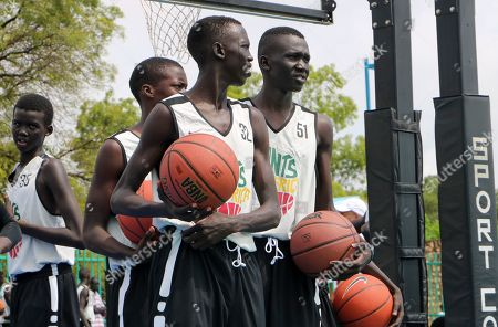 Stock Image of Players stand on the court doing exercises during a three-day basketball training camp run by Giants of Africa in Juba, South Sudan. Masai Ujiri, president of the Toronto Raptors basketball team who won the NBA championship for the first time this year, is founder of the Giants of Africa non-profit organization which runs a three-day training camp in South Sudan to empower youth through basketball