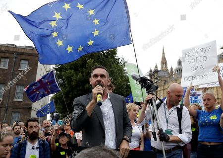 Journalist Paul Mason delivers a speech near the Houses of Parliament in central London, . British Prime Minister Boris Johnson asked Queen Elizabeth II on Wednesday to suspend Parliament, throwing down the gauntlet to his critics and causing outrage among opposition leaders who will have even less time to thwart a no-deal Brexit