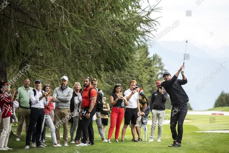 Stock Image of US musician Justin Timberlake in action during the pro-am golf tournament in Crans-Montana, Switzerland, 28 August 2019.