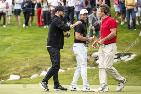 (L-R) US musician Justin Timberlake, golfer Rory McIlroy of Northern Ireland and US actor Dennis Quaid during the pro-am golf tournament in Crans-Montana, Switzerland, 28 August 2019.