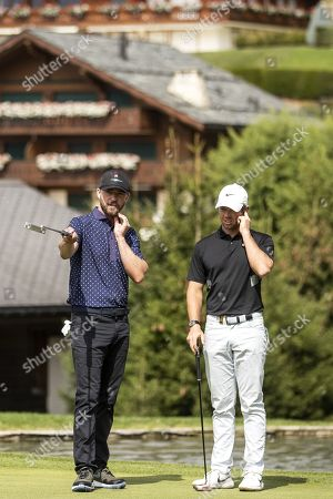 US musician Justin Timberlake (L) and golfer Rory McIlroy of Northern Ireland during the pro-am golf tournament in Crans-Montana, Switzerland, 28 August 2019.