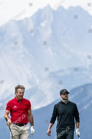 US actor Dennis Quaid (L) and US musician Justin Timberlake during the pro-am golf tournament in Crans-Montana, Switzerland, 28 August 2019.