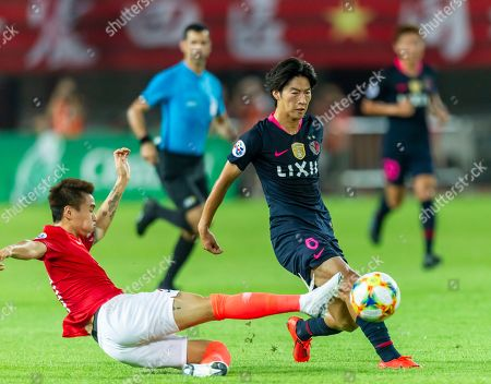 Shoma Doi of Kashima Antlers (R) in action against Wei Shihao of Guangzhou Evergrande (L) during the AFC Champions League quarter final first leg match between Guangzhou Evergrande and Kashima Antlers in Guangzhou, China, 28 August 2019.