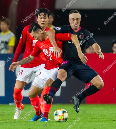 Serginho of Kashima Antlers (R)  in action against Liu Dianzuo of Guangzhou Evergrande (C) and Park Ji-Soo of Guangzhou Evergrande (L) during the AFC Champions League quarter final first leg match between Guangzhou Evergrande and Kashima Antlers in Guangzhou, China, 28 August 2019.