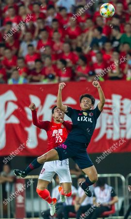 Park Ji-Soo of Guangzhou Evergrande (L) in action against Ayase Ueda of Kashima Antlers (R) during the AFC Champions League quarter final first leg match between Guangzhou Evergrande and Kashima Antlers in Guangzhou, China, 28 August 2019.