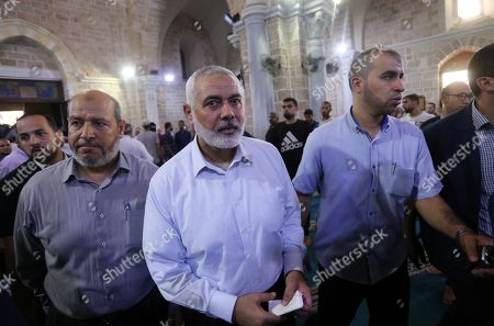 Head of the Political Bureau of Hamas Ismail Haniyeh attends the funeral of Palestinian policemen Salama al-Nadeem and Alaa al-Gharabli, in Gaza City