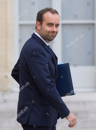 French deputy minister, Sebastien Lecornu leaves after the weekly cabinet meeting at Elysee Palace.