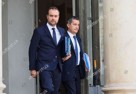 French deputy minister, Sebastien Lecornu and French Public Accounts Minister Gerald Darmanin leave after the weekly cabinet meeting at Elysee Palace.