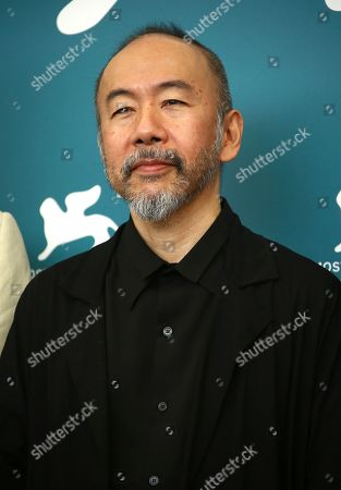 Jury member Shinya Tsukamoto poses for photographers at the photo call for the jury at the 76th edition of the Venice Film Festival in Venice, Italy