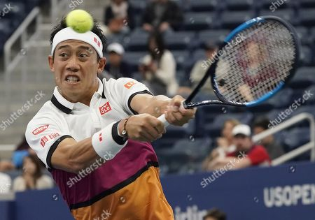 Kei Nishikori of Japan hits a return to Bradley Klahn of the US during their match on the third day of the US Open Tennis Championships the USTA National Tennis Center in Flushing Meadows, New York, USA, 28 August 2019. The US Open runs from 26 August through 08 September.