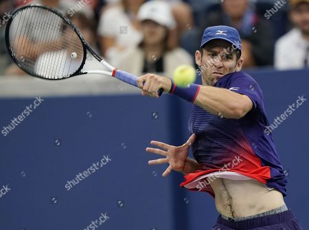 Bradley Klahn of the US hits a return to Kei Nishikori of Japan during their match on the third day of the US Open Tennis Championships the USTA National Tennis Center in Flushing Meadows, New York, USA, 28 August 2019. The US Open runs from 26 August through 08 September.