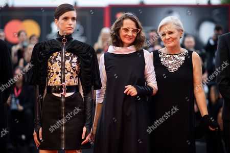 Mary Harron, Lucrecia Martel, Stacy Martin. Jury members Mary Harron, from right, jury President Lucrecia Martel and Stacy Martin pose for photographers upon arrival at the premiere of the film 'The Truth' and the opening gala at the 76th edition of the Venice Film Festival, Venice, Italy