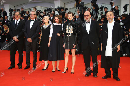 Shinya Tsukamoto, Piers Handling, Stacy Martin, Mary Harron, Jury President Lucrecia Martel, Paolo Virz', Rodrigo Prieto. Jury members Rodrigo Prieto, from left, Piers Handling, Mary Harron, Jury President Lucrecia Martel, Stacy Martin, Paolo Virzì and Shinya Tsukamoto pose for photographers upon arrival at the premiere of the film 'The Truth' and the opening gala of the 76th edition of the Venice Film Festival, Venice, Italy