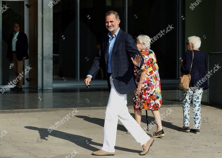 Spain's King Felipe VI smiles upon arrival at Hospital Quiron Salud Madrid for visiting his father emeritus king Juan Carlos I (unseen), in the town of Pozuelo de Alarcon, outside Madrid, Spain, 28 August 2019. The monarch recovers in the hospital from a triple bypass surgery last 24 August.